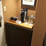 coffee maker, ice bucket and refrigerator just inside the door