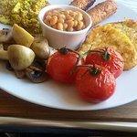 Vegan Breakfast - scrambled tofu, Linda M sausages, hash browns, tomatoes, beans & mushrooms.