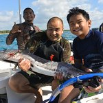 Carlo, Me, and a Barracuda. Diego our guide and my little girl boat sick!