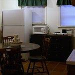 Fiesta Suite Kitchenette- dining table, wet- bar, 2-burner range-top, microwave, full size fridg
