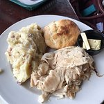 Open face turkey sandwich with a biscuit