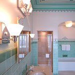Amyotte Junior Suite historic art deco bathroom, with shower and soaker tub.
