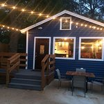 Outdoor seating and lighting is so quaint and comfortable.