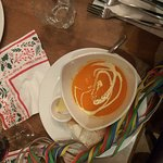 Roasted Red Pepper and Sweet Potato Soup (v) Mildly spiced, garnished with cream and served with