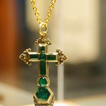 Emerald and gold cross