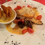 white fish fillet with eggplant, tomato and peppers with mashed sweet potato side