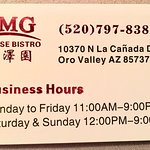 Business card with hours.
