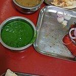 Palak Paneer (green) Tandoori Chicken (veg!) and Madras veg. lamb. Palak Paneer recommended.