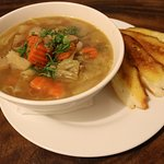 Irish Stew: Giant bowl of delicious pork based stew served with a slice of crispy baguette