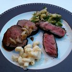 Pepper crusted Chateaubriand, bone-in ribeye, mac and cheese, Brussells sprouts