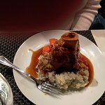Tender, juicy Osso Bucco served over mashed potatoes.