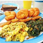 traditional breakfast of ackee and salt fish with callalo