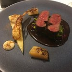 Sika venison with poached parsnip and charred quince, braised cabbage, and mashed potatoes