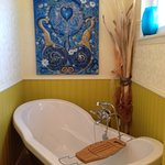 Beautiful painting above the soaker tub. The bathroom is huge -this is only one area of the bath