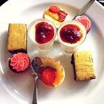 Sweets: fruit tartlets, red velvet cupcakes, vanilla pannacotta w/berry coulis & chocolate slice