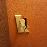 This outlet is downright dangerous! If I had children I would have demanded another room!