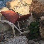 One derelict lawn chair next to the pool