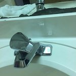 Weird position of faucet to keep water off, mirror deteriorating