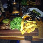 Steak with chips, side dish of asparagus