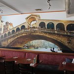 Inside dining area with wall mural