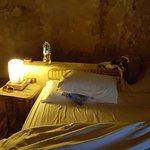 Room with palm beams, mud walls, salt lamps and clean sheets