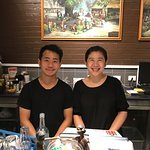 Phuket (l), wait staff and Amy, owner