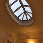 View of the skylight over the beautiful staircase.