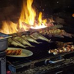 All grilled items are cooked over wood