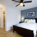 Master bedroom includes queen size bed, bathroom, safe, & walk-in closet.