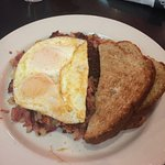 Corned Beef Hash with eggs over easy & wheat toast