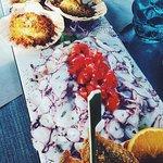 Antipasto di pesce, mousse di baccalà, capesante, sardoni fritti e polipo