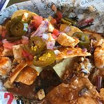 A half order of chicken nachos was huge & so filling we couldn't even eat our chicken taco/salad