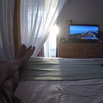 Resting in room one hour before sunset, you can see ocean from our bed.