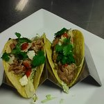 Pork Tacos w/ melt in your mouth slow roasted Pork. Fresh parmesan shavings, cilantro, red sauce