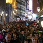 typical central Madrid street on evening of Día de la Constitución 6th Dec