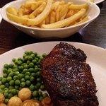 16oz Porterhouse Steak and Cheese Omlette.