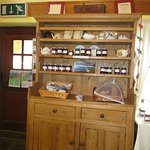 Cupboard filled with baked goodies & jars of preserves