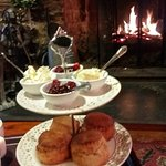 Cream tea in front of the log fire.