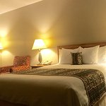 Motel room with queen pillow top mattress
