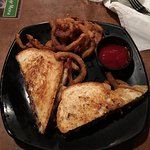 Reuben Sandwich With Onion Strips At River's Bend Grill