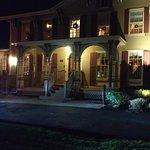 The Inn lit up at night.