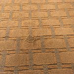 Tattered worn out carpeting in room