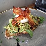 Poached egg with avocado and bacon on sourdough