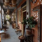 The outside patio where you can enjoy your coffee, and listen to the music being played downstai