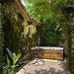 Villa Two outdoor spa in private garden patio.