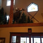 Christmas moose welcoming guests in the entrance foyer.