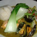 Malaysian fish stew with sticky coconut rice and steamed pak choi