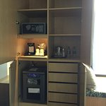 Large armoire with minibar, coffee, safe and drawers