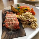 Salmon with rice pilaf and veggies.