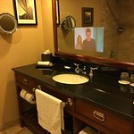 TV super-imposed in bathroom mirror